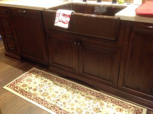 Detail, furniture toe and apron sink